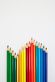Colorful wooden pencils for drawing on white a background