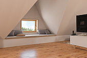 3d illustration interior design ilving room of the attic floor of a private cottage