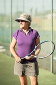 Senior woman on tennis court