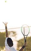 Tennis player serving the ball