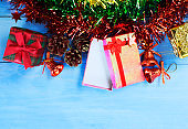 Christmas holiday and happy new year background with gift box and decorations, top views