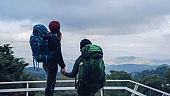 Asian couples travel nature on the mountains in winter.Travel relax. Natural touch countryside at doi inthanon in Thailand.