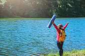 Asian woman travel nature. Travel relax yoga exercise.