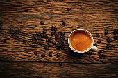 Coffee cup and beans on old wood table. espresso