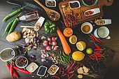 Healthy food herbs Spices for use as cooking ingredients on a wooden background with Fresh organic vegetables on wood. The concept of food ingredients with Variety on the rustic table.