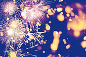 Fireworks at New Year and copy space abstract holiday background. Brightly Colorful Fireworks on twilight background with free space for text. New Year