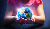 Child Hold World - Earth Day Concept
