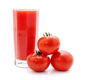 Glass of tomato juice and tomato.