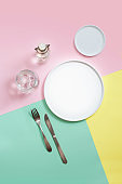 Empty plates on colourful background.