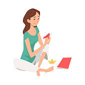 Young Woman Making Origami Boats from Colorful Papper, Craft hobby or Profession, Girl in Everyday Life, Daily Routine Vector Illustration