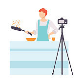 Man Cooking at Kitchen and Recording Video on Camera, Male Food Blogger Creating Content about His Hobby and Posting It on Social Media Vector Illustration