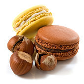 image of macarons and hazelnuts on a white background
