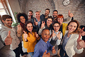 Group of businessman and businesswoman team giving thumb up sign of success business teamwork