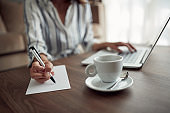 Businesswoman working – woman hand writing content or somethings on notebook with using laptop, lifestyle concept