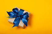 Attractive gift on the orange background