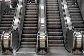 Escalator - subway, shopping mall and business center escalator - moving staircase