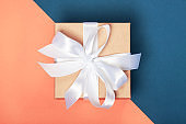 Attractive gift on the coral and blue background