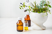 Bottles of essential oil, white background. Healthy cosmetics concept.