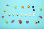Teeth with sweet candies. Tooth caries in children's, dental healthcare