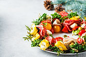 Christmas food background. Christmas wreath of holiday snacks.