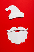 Concept portrait of Santa Claus with beard and hat on red background. Winter holidays, modern and creative Xmas in minimal style