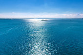 Beautiful river Volga landscape - the sun is reflected in the water and the island
