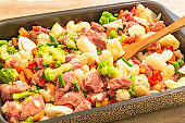 Cooking stews of frozen and fresh vegetables and meats