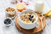 Granola bowl with fruits and milk