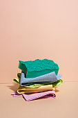 Pile of dish cloths in different colors.