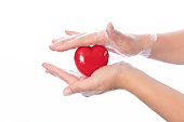 Healthy Woman Holding Heart with soapy hands