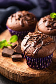 Chocolate cakes decorated with chocolate and mint leaf