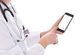 Portrait of female doctor using her digital tablet on white background