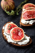 Tasty rye bread toast with cream cheese and figs