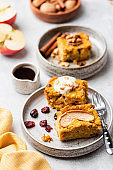 Sweet pumpkin cake with walnuts, cinnamon and dried cranberry