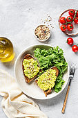 Rye toast with mashed avocado and kale salad