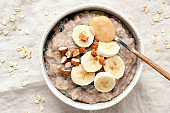 Bowl of oatmeal porridge with banana and peanut butter
