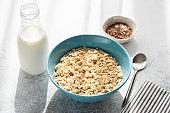 Healthy Breakfast, oatmeal porridge in bowl and bottle of milk