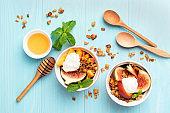 Fruits, granola and greek yogurt cream bowl