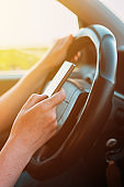 Dangerous texting while driving behavior, close up