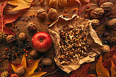 Autumn fruit, apple and walnuts, top view