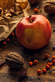 Tasty red apple and walnut fruit on table