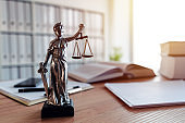 Lady Justice statue in law firm attorney office