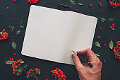 Flat lay hand writing diary, top view