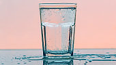 Carbonated soda water in drinking glass