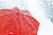 Close up of red umbrella in snow