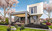 3d rendering of modern house with garden in spring
