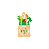 Textile eco friendly reusable shopping bag full of vegetables and other products.