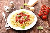 spaghetti with tomato sauce, basil and parmesan
