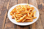 french fries on wood background
