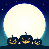 Halloween pumpkins on blue moon background
